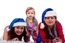 Family In Santa S Hat Lying In Artificial Snow Stock Photography
