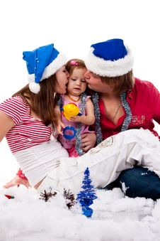 Free Parents In Santa S Hat Kissing Their Child Royalty Free Stock Photos - 17443858