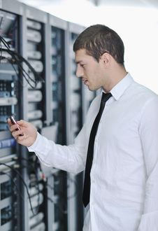 Free Young Engeneer In Datacenter Server Room Royalty Free Stock Photography - 17444697