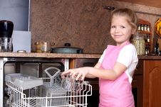 Girl Taken Glass From Dishwasher Royalty Free Stock Photography