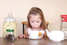 Free Little Girl Blowing To Cup Of Hot Drink Royalty Free Stock Images - 17444789