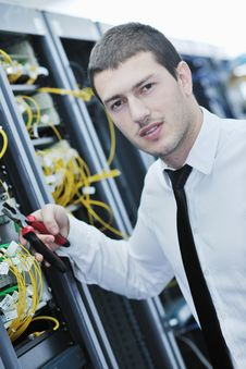 Free Young Engeneer In Datacenter Server Room Royalty Free Stock Photos - 17446198