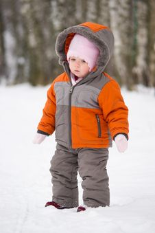 Cute Baby Stay On Snow Road Royalty Free Stock Photos