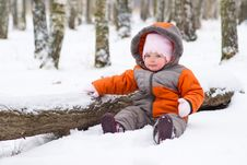 Baby Sit On Snow In Park Near Tree Stock Images
