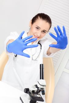 Free Medical - Female Nurse Looking In Microscope Royalty Free Stock Photo - 17448335
