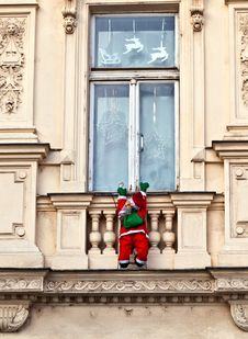 Free Santa Claus Is Climbing Up A Facade Stock Photo - 17449730