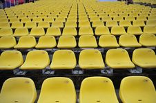 Free Yellow Plastic Chair Royalty Free Stock Photo - 17450565