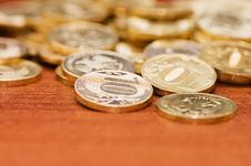 Golden Coins On A Wooden Table Stock Photos
