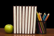 Free Stack Of Books And Apple On A Wooden Table Stock Photos - 17451193