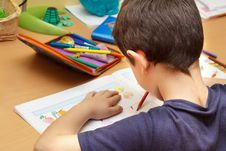 Free Boy Doing Homework  With Color Pencil Stock Images - 17451544