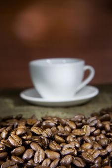 Free Cup Of Coffee And Beans On Sacking Royalty Free Stock Photography - 17451867