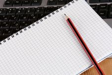Free Pencil And Notebook On Keyboard Royalty Free Stock Photo - 17452045