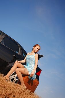 Free Girl With Suitcase Near The Car Royalty Free Stock Photo - 17454015