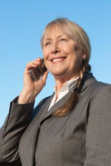 Free Happy Mature Businesswoman Using Cellphone. Royalty Free Stock Photography - 17454987