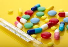 Colorful Pills And Thermometer Stock Photography