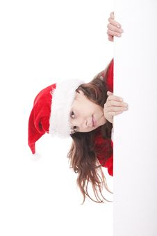 Girl Dressed As Santa Claus Holds Advertisement Stock Photo