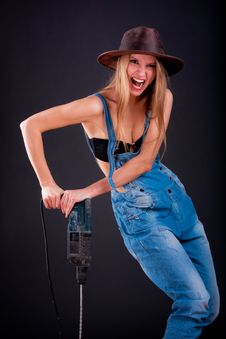 Girl With A Drill Stock Images