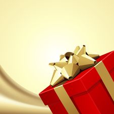 Free Red Gift With Gold Bow On Silk Royalty Free Stock Photos - 17469878
