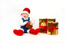 Free Little Boy In Santa Hat With A Bunch Of Gifts Stock Photos - 17469953