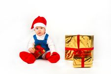 Free Little Boy In Santa Hat With A Bunch Of Gifts Royalty Free Stock Photos - 17469968