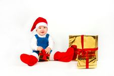 Free Little Boy In Santa Hat With A Bunch Of Gifts Stock Photo - 17469980