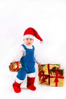 Free Little Boy In Santa Hat With A Bunch Of Gifts Royalty Free Stock Photography - 17469997