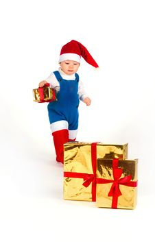 Free Little Boy In Santa Hat With A Bunch Of Gifts Royalty Free Stock Image - 17470006