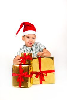 Free Little Boy In Santa Hat With A Bunch Of Gifts Royalty Free Stock Images - 17470029