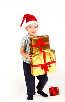 Free Little Boy In Santa Hat With A Bunch Of Gifts Stock Image - 17470061