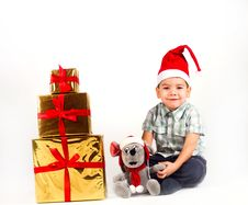 Free Little Boy In Santa Hat With A Bunch Of Gifts Royalty Free Stock Image - 17470066