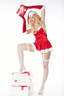 Free Sexy Blonde Santa Girl Holding A Present Royalty Free Stock Photos - 17470118