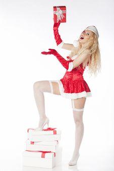 Free Sexy Blonde Santa Girl Holding A Present Stock Photo - 17470120