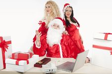 Free Santa Claus With Two Sexy Helpers In His Office Stock Photography - 17470292