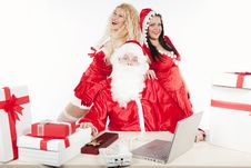 Santa Claus With Two Sexy Helpers In His Office Royalty Free Stock Photos