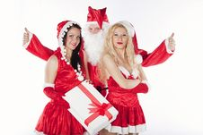 Santa Claus With Two Sexy Helpers In His Office Royalty Free Stock Images