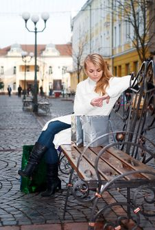 Free Young Woman Sitting On A Bench Stock Images - 17470804