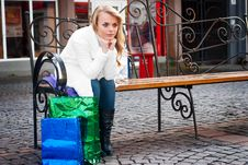 Free Young Woman Sitting On A Bench Stock Image - 17470911
