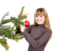 The Girl Decorating The Christmas Tree