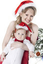 Free Woman And Baby In Red Christmas Hats Stock Image - 17489561