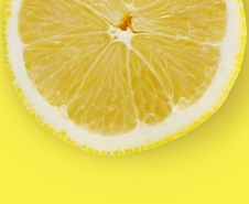 Free Lemon Slice On Yellow Background Stock Images - 17482174