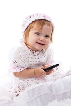 Free Beautiful Baby With A Mobile Phone Stock Photography - 17483052