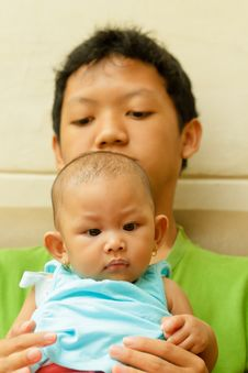 Free Asian Teen Boy Hold A Baby Royalty Free Stock Photos - 17483528