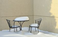 Iron Patio Table And Chairs Covered With Snow. Stock Images