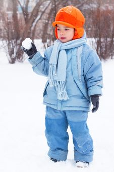 Little Boy Playing Snowballs, Snowman Sculpts Stock Image