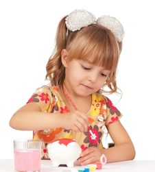 Girl With Piggy Bank Stock Image