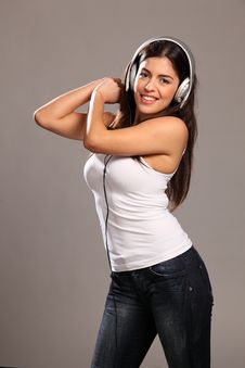 Free Beautiful Young Woman Happy And Dancing To Music Royalty Free Stock Images - 17489169