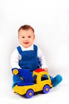 Free Happy Little Boy Playing With Cars And Toys. Stock Photos - 17491003