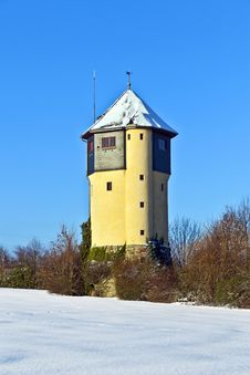 Watertower In  Snow Covered Fields Royalty Free Stock Image