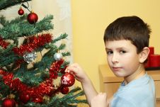 Free Young Boy Holding Christmas Decorations Stock Photo - 17495150