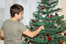 Free Young Boy Holding Christmas Decorations Stock Image - 17495211